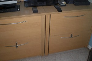 Two lateral file cabinets hold almost everything